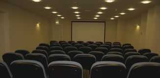 Cinema Room. Empty chairs at cinema or theater. Blue Tone Royalty Free Stock Image