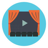 Cinema room with row of gray sits in front of movie screen with play symbol and red act curtains Royalty Free Stock Image