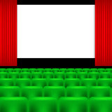 Cinema screen and green seats Stock Photo