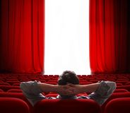 Cinema screen red curtains opening for vip person Stock Photos