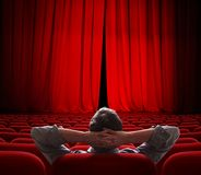 Cinema screen red curtains slightly open for vip. Cinema screen red curtains slightly open for one vip person Royalty Free Stock Images