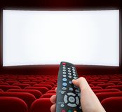 Cinema screen with remote control in hand. Movie screen with remote control in hand Stock Images