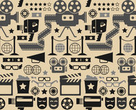 Cinema seamless background. Seamless background with cinema symbols and silhouettes Stock Images