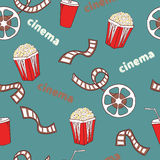 Cinema seamless pattern. Bright cinema symbols - popcorn, film reel and strip. On blue. Vector background Royalty Free Stock Images