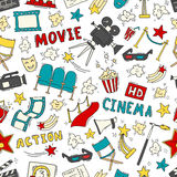 Cinema seamless pattern with hand drawn elements. Cinema colorful seamless pattern with hand drawn elements. Background with clapperboard, camera, chairs, awards Stock Photo