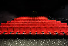Cinema seats. Red seats in a movie theater royalty free stock photo