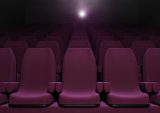 Cinema seats. 3d computer generated image of red cinema seats with a light projector on the background Royalty Free Stock Photography