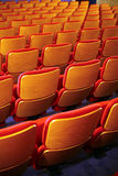 Cinema seats. Color vertical shot of some seats in a cinema hall stock photography