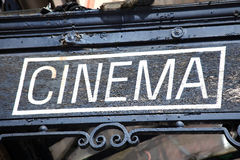 Cinema Sign. Old cinema movie theatre sign advertising night life family entertainment Royalty Free Stock Photo