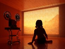 Cinema. Silhouette of a child outside the movie camera Royalty Free Stock Images