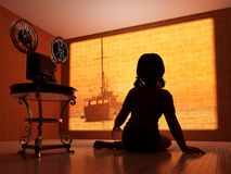 Cinema. Silhouette of a child outside the movie camera Stock Image