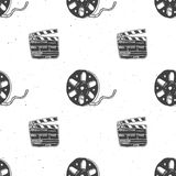 Cinema tape, film reel and clapperboard vintage seamless. Cinema tape, film reel and clapperboard vintage seamless pattern, handdrawn sketch, retro movie and Stock Image