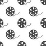 Cinema tape and film reel vintage seamless pattern, handdrawn sketch. Cinema tape and film reel vintage seamless pattern, handdrawn sketch, retro movie and film Royalty Free Stock Image