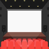 Cinema theater with seats and blank screen Royalty Free Stock Images