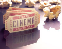 Cinema Ticket. Entry ticket to the cinema with popcorn around Stock Image