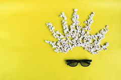Cinema time on yellow paper background. Abstract image of movie viewer, 3D glasses, popcorn. Concept cinema movie and royalty free stock image