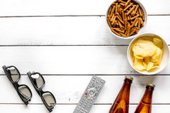Cinema and TV whatching with beer, crumbs, chips white wooden background top view mock-up. Cinema and TV whatching with beer, crumbs, chips on white wooden Royalty Free Stock Photo