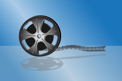 Cinema video film. Isolated on blue background Stock Photos