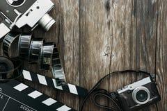 Cinema and videomaking. Vintage film camera, clapper board, filmstrip and old camera on a desktop, cinema and videomaking concept Stock Photography