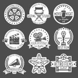 Cinema White Emblem Set. Cinema white emblem or label set round and in form of figures with ribbons vector illustration Stock Images
