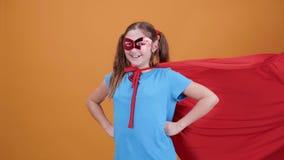 CINEMAGRAPH του μικρού κοριτσιού στο κοστούμι superhero απόθεμα βίντεο