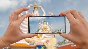 Cinemagraph brać Mobilną fotografię Guan Yin statua przy Plai Laem świątynią Główny symbol i Popularny Samui punkt zwrotny - zbiory