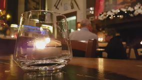 Cinemagraph effect on candle flame inside a glass. Beautiful cinemagraph effect on candle flame inside a glass stock video footage