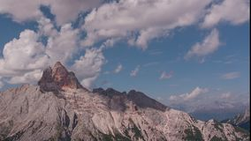 Cinemagraph effect with motionless clouds and moving shadows on dolomite wall. Cinemagraph effect with motionless clouds and moving shadows on the Croda Rossa stock video footage