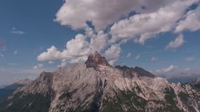 Cinemagraph effect with motionless clouds and moving shadows on dolomite wall. Cinemagraph effect with motionless clouds and moving shadows on the Croda Rossa stock video
