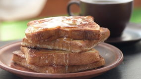 Cinemagraph -French toasts with honey. stock footage
