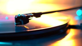 Cinemagraph loop vinyl record player turntable with it`s stylus running along music plate. Neon light. Retro-styled