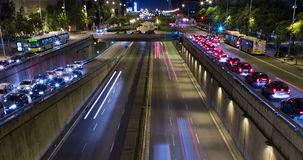 Cinemagraph of night scene of urban traffic.Time Lapse - Trail effect - Long exposure - 4K. (02). Cinemagraph of night scene urban, underground traffic in motion stock video footage