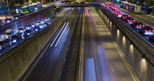 Cinemagraph of night scene of urban traffic.Time Lapse - Trail effect - Long exposure - 4K. (06). Cinemagraph of night scene urban, underground traffic in motion stock video footage