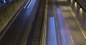 Cinemagraph of night scene of urban traffic.Time Lapse - Trail effect - Long exposure - 4K. (04). Cinemagraph of night scene urban, underground traffic in motion stock video footage