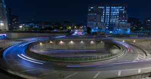 Cinemagraph of roundabout above highway.Time Lapse. Cinemagraph of roundabout above highway. Night scene urban traffic, of Barcelona, underground traffic in stock footage