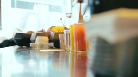 Cinemagraph of steaming hot water in glass on the counter in a cafe.  stock footage