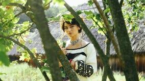 Cinemagraph - Ukrainian girl in sunrays posing on camera . stock footage