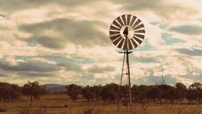 Cinemagraph of a windmill in the countryside. Of Queensland, Australia stock video footage