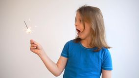 Cinemagraph of young boy with sparkler. Cinemagraph of young blond boy with sparkler stock video