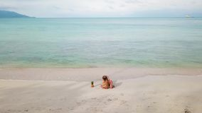 Cinemagraph of young woman relax on the beach stock footage