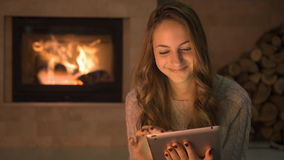 Cinemagraph - Young woman using tablet .