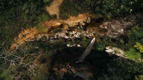 Cinematic aerial drone photo of waterfall and a small pool deep in the rainforest jungle at Amboro National Park, Bolivia stock photo