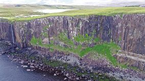 Cinematic aerial shot of the dramatic coastline at the cliffs close to the famous Kilt Rock waterfall ,Skye. Scotland stock video