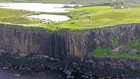 Cinematic aerial shot of the dramatic coastline at the cliffs close to the famous Kilt Rock waterfall ,Skye. Scotland stock footage