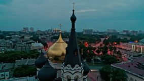 Cinematic aerial view of orthodox cross on spire of Church in Odessa at evening. Cinematic aerial view of orthodox cross on spire of Church in Odessa at late stock video