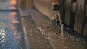 Cinematic establishing shot of an alleyway during a storm. Cinematic establishing shot of rain draining into an alleyway during a storm. 4K footage stock footage