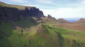 Cinematic flight over the Quiraing on the eastern face of Meall na Suiramach, Isle of Skye, Highland, Scotland stock video footage