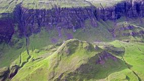 Cinematic flight over the Quiraing on the eastern face of Meall na Suiramach, Isle of Skye, Highland, Scotland stock video