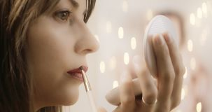 Cinematic make up glamour series. Shot in 4K RAW slow motion on a cinema camera. Anamorphic bokeh stock footage