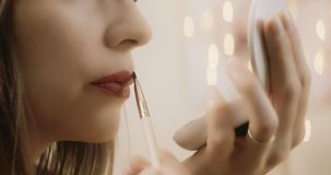 Cinematic make up glamour series. Shot in 4K RAW slow motion on a cinema camera. Anamorphic bokeh stock video footage